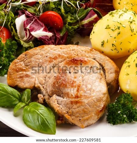 Fried Pork Chop Boiled Potatoes And Vegetable Salad