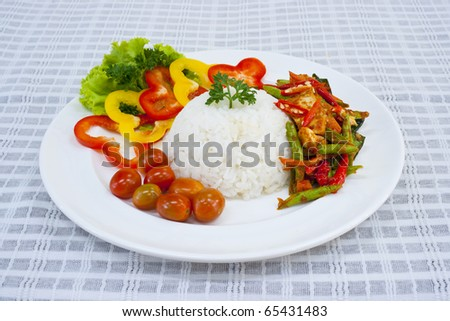 Fried pork curry served with rice and vegetable