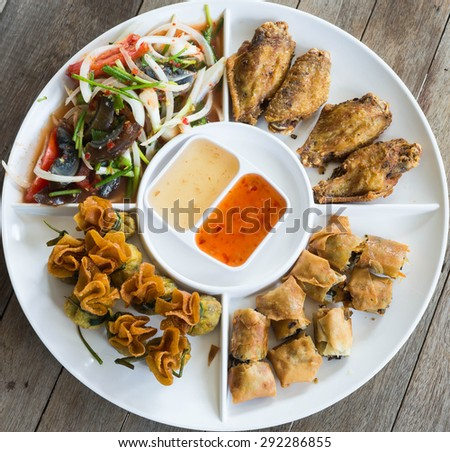 Fried pork dumplings wrapped, Fried chicken,preserved egg salad, food of thailand - stock photo