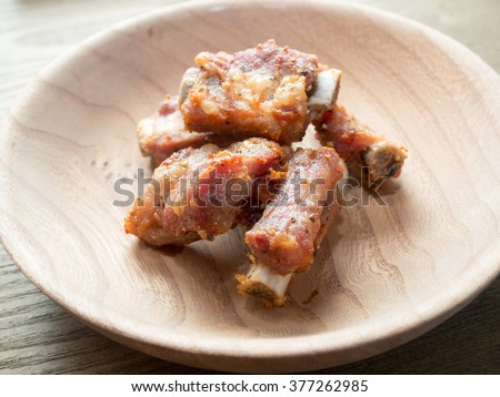 Fried pork ribs with black pepper - stock photo