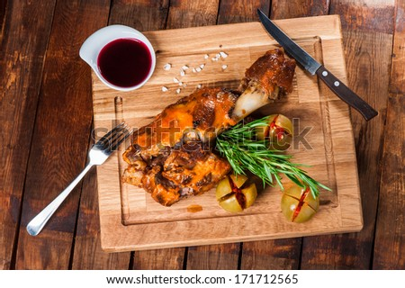Fried pork shank with cheese, marinated tomatoes and sweet sauce - stock photo