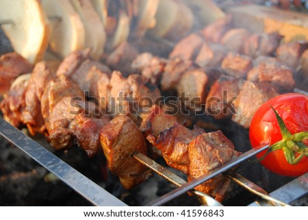 fried pork with tomato and bread - stock photo