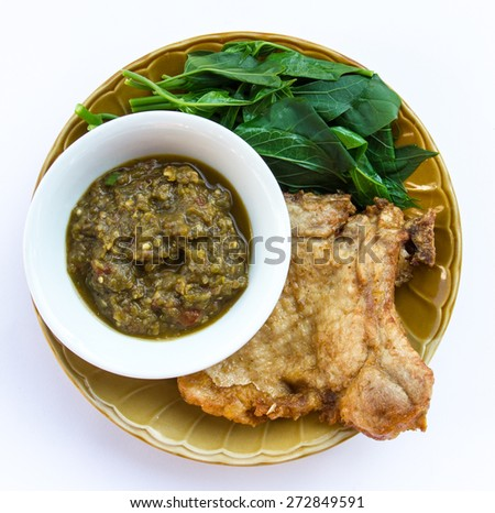 Fried pork with vegetables Thai food consists of chili sauce and fermented fish. - stock photo