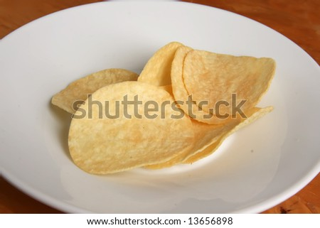 Fried potato chip snack food in white plate