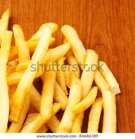 fried potato chips on a wooden surface
