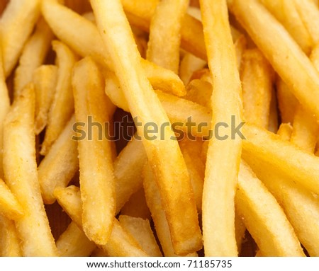 fried potato chips pile, extreme closeup photo - stock photo