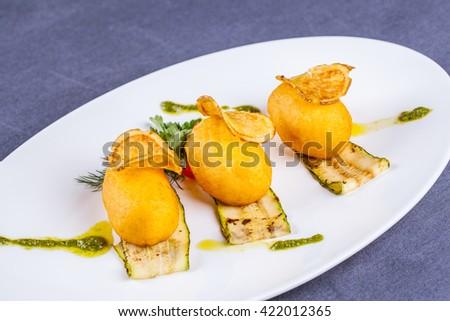 Fried potato croquettes on white plate - stock photo