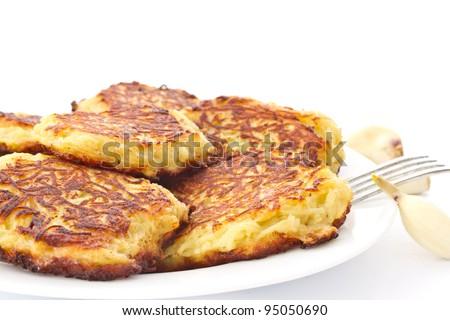 fried potato pancakes on a plate on a white background - stock photo