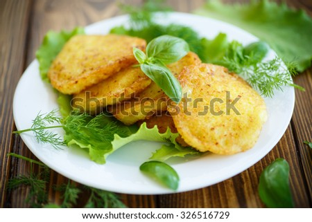 fried potato pancakes with herbs and basil - stock photo