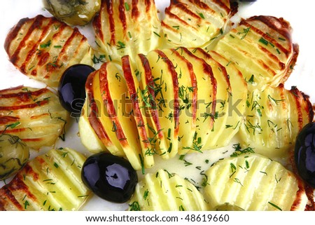 fried potatoes and olives over white background - stock photo