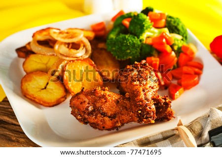 Fried potatoes broccoli carrots and roasted chicken - stock photo