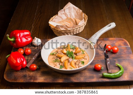Fried Potatoes in a Skillet. Sweet and Chili Peppers. - stock photo