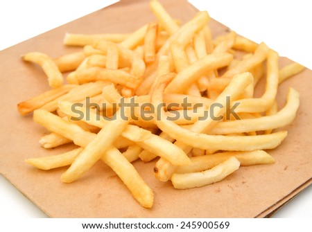 fried potatoes in brown paper on white background  - stock photo