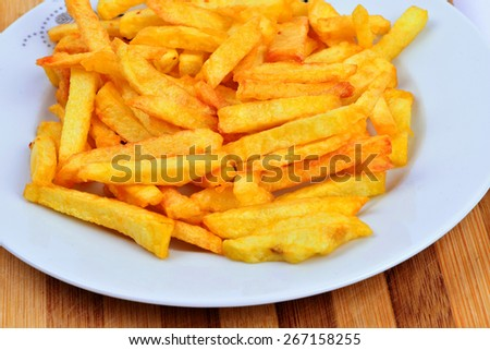 fried potatoes in dish - stock photo