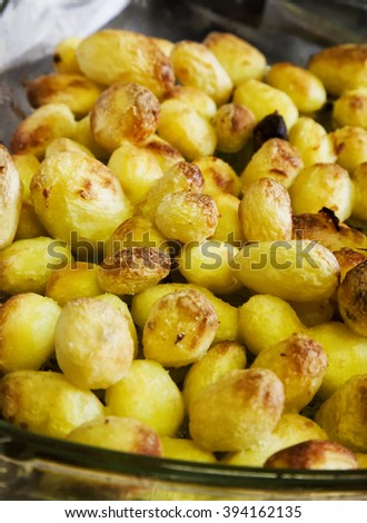Fried potatoes in glass tray, vertical image - stock photo