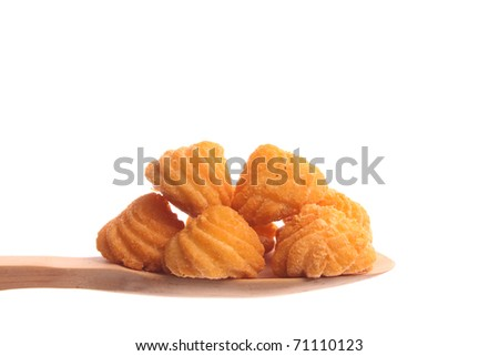 Fried potatoes  simply offered on a wooden spoon isolated on a white background