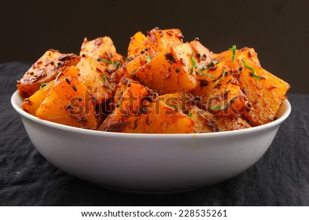 Fried potatoes with herbs .shallow depth of field photograph.  - stock photo
