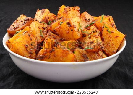 Fried potatoes with herbs .shallow depth of field photograph. shallow depth of field photograph.  - stock photo