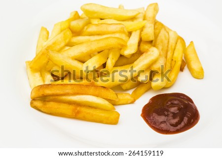 Fried potatoes with ketchup - stock photo