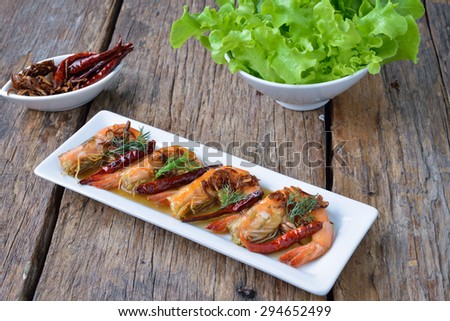Fried Prawn  shrimp with Tamarind Sauce in white plate on wood background - stock photo