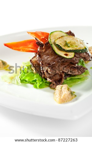 Fried Prime Beef on Salad Leaf Topped with Zucchini