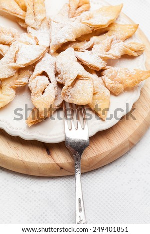 Fried rader cake dusted with castor sugar. - stock photo