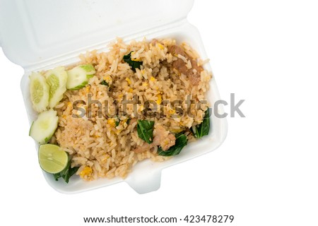 Fried rice in foam box isolated on white background