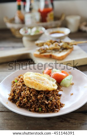Fried rice nasi goreng with chicken and vegetables  - stock photo