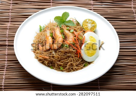 Fried Rice Noodle on a wooden matte - stock photo