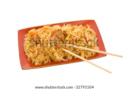 Fried rice on serving platter with chopsticks isolated over white background - stock photo