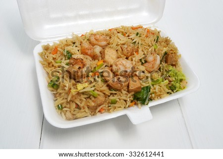 fried rice recipe in take out box - stock photo