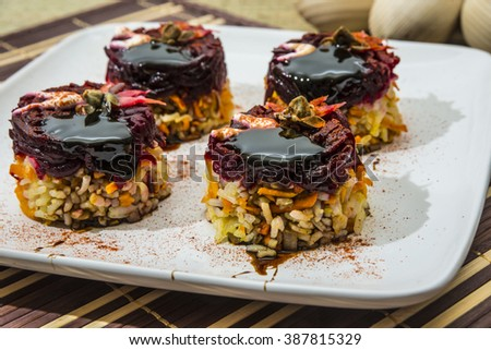 Fried rice towers under beet salad