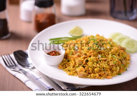 Fried Rice Turmeric with meat, select focus - stock photo