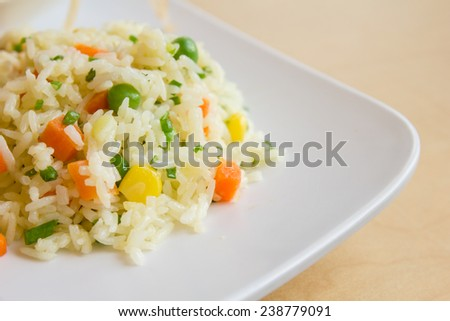 fried rice with butter on white dish. Thai food - stock photo