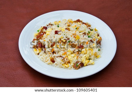 Fried rice with ham and eggs. - stock photo