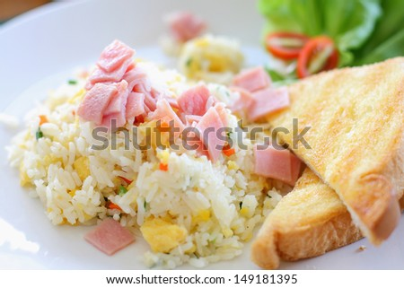 Fried rice with ham, served with toast - stock photo
