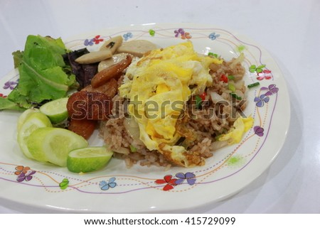 fried rice with pork, fish,free egg and Vegetable on dish,thai food street,savory thai food,spicy fried rice,thai food - stock photo