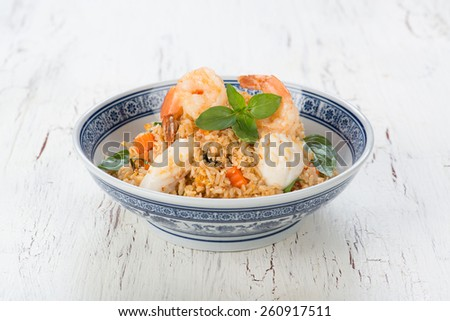 Fried rice with prawns and vegetables - stock photo