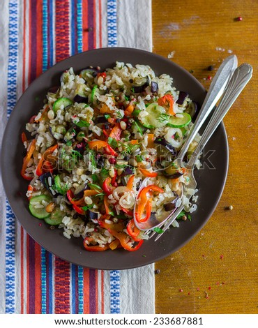 Fried rice with red pepper, eggplant and zucchini in a plate - stock photo
