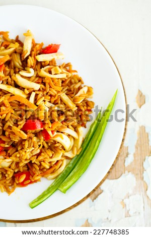 Fried rice with seafood. Asian cuisine. Khao Pad. Thai spicy food. - stock photo