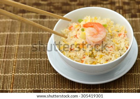 Fried Rice with shrimp and chopsticks for breakfast  - stock photo