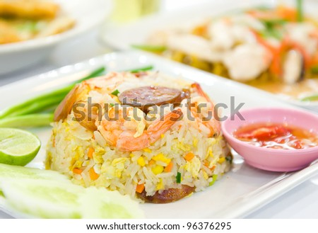 fried rice with shrimp and vegetable and sausage - stock photo