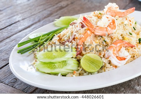 Fried rice with shrimp on the old wooden table