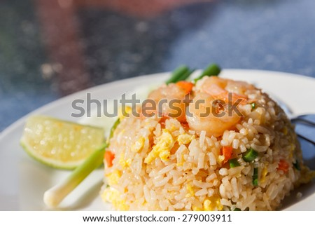 fried rice with shrimp on top - stock photo