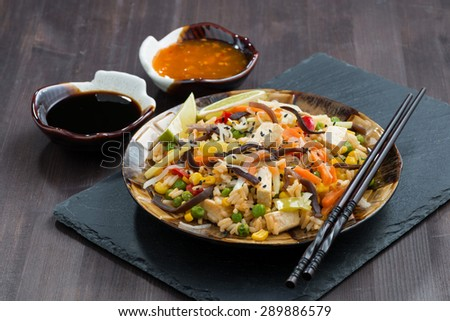 fried rice with tofu, vegetables and sauces, horizontal - stock photo
