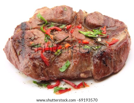 Fried roast beef with spices on a white background - stock photo
