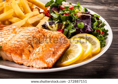 Fried salmon and vegetables - stock photo