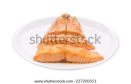 Fried salmon fillet. Isolated on a white background. - stock photo