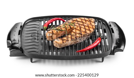 Fried salmon steak on grill. Isolated on a white background. - stock photo