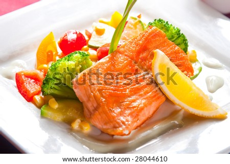 fried salmon with vegetables - stock photo